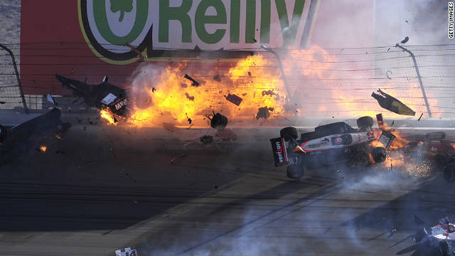 The car of Dan Wheldon disintegrates and bursts into flames in a 15-car pileup during Sunday's Las Vegas Indy 300.