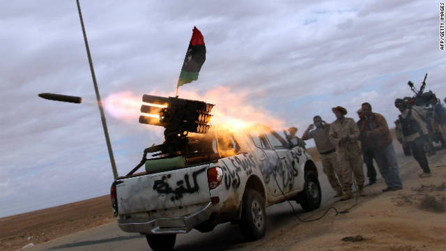 NTC fighters launch a rocket toward the desert city of Bani Walid on October 11, 2011.