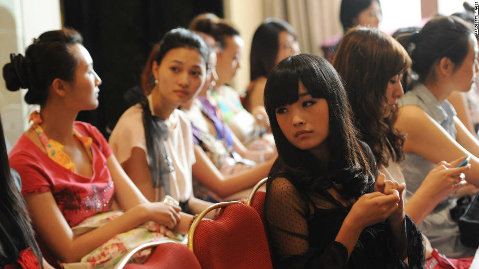 In a picture taken on June 21, 2011 young Chinese women wait their turn during a qualifying for the Miss Chinese Cosmos beauty pageant in Beijing.