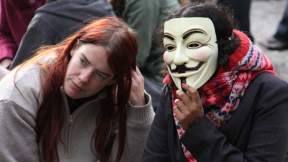 "Another protester sports the mask, made famous by the film ""V for Vendetta,"" at the Occupy London demonstration at St Paul"