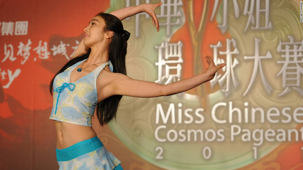 In a picture taken on June 21, 2011 a young Chinese woman performs on stage during a qualifying for the Miss Chinese Cosmos beauty pageant in Beijing.