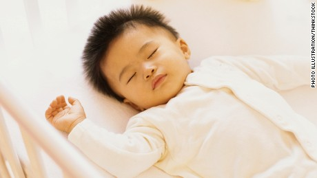 Babies may sleep longer in their own rooms, study says