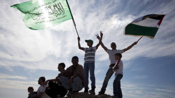 Palestinians celebrate the release of Palestinian prisoners in a deal that freed Israeli soldier Gilad Shalit.