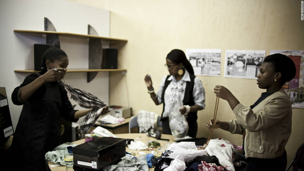 The Project co-ordinator, Nkuli Mlangeni, helps some of the contributors prepare the clothes to style Live magazine's first fashion editorial.