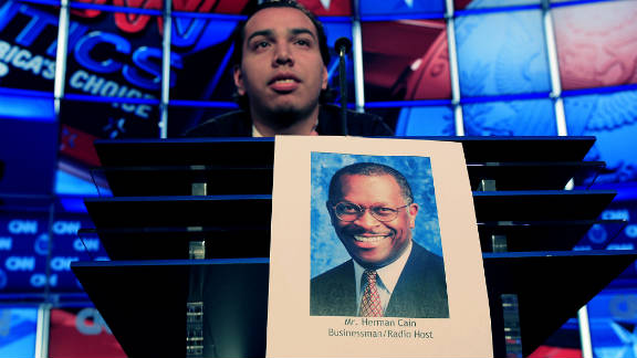 University of Nevada student Peter Galvan stands in for Herman Cain during Tuesday