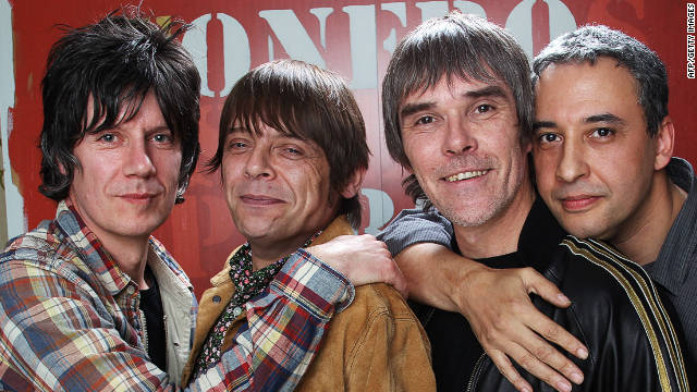 All smiles: John Squire, Mani, Ian Brown and Reni of The Stone Roses pose together to announce their comeback dates.