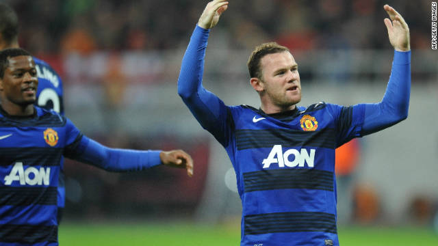 Wayne Rooney scored two penalties to secure Manchester United's first win in the UEFA Champions League this season