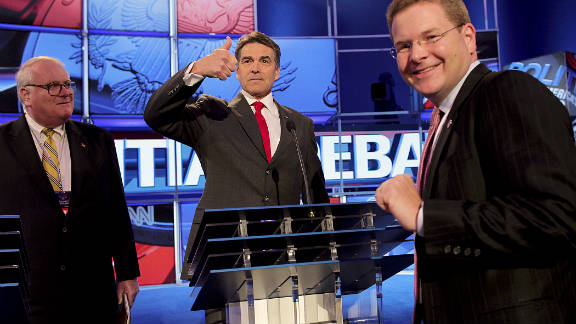 Perry gives the thumbs up at rehearsal.  The bad blood between Romney and Perry boiled over in the debate