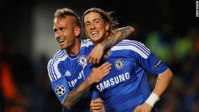 Fernando Torres is congratulated by Raul Mereiles after scoring at Stamford Bridge against Genk