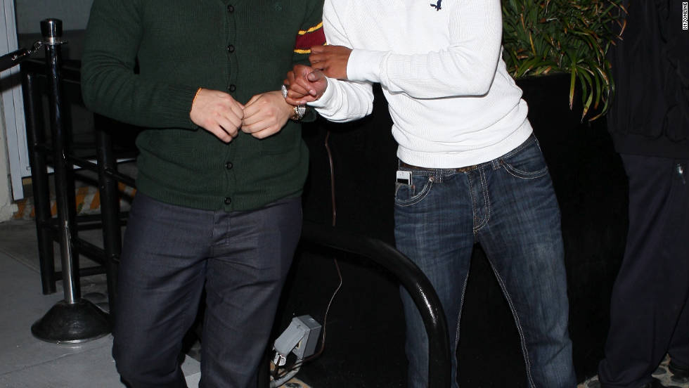 Rob Kardashian and Romeo hang out at a party in Los Angeles.