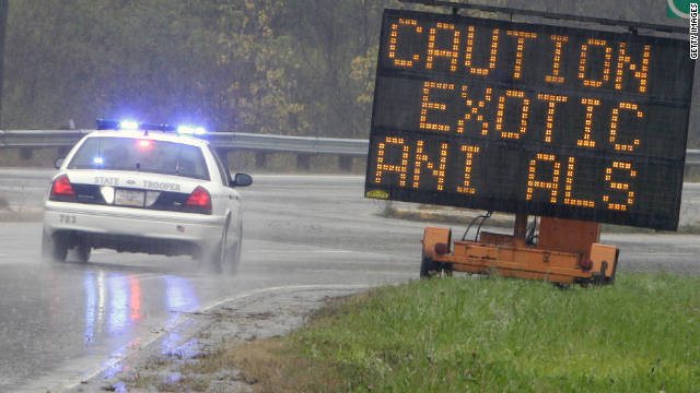 A sign warns drivers Wednesday in Zanesville, Ohio. Gov. John Kasich says he wants to tighten laws for exotic animals.