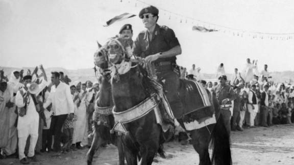 Gadhafi rides a horse through Tripoli in November 1975.