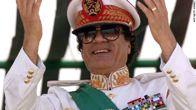 Moammar Gadhafi salutes his troops at a 1999 parade to mark the 30th anniversary of the revolution that brought him to power.