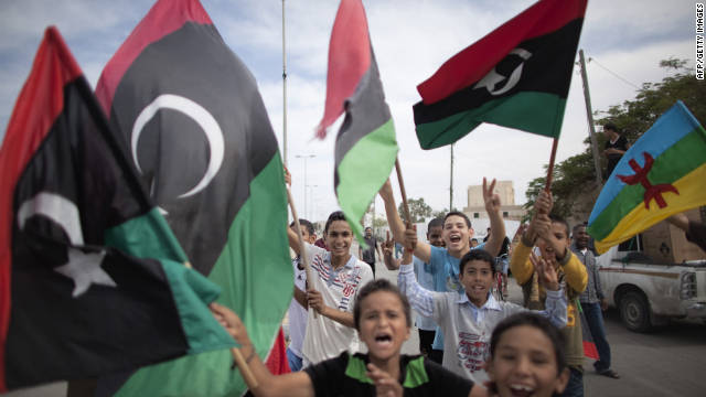 Libyan children waving National Transitional Council (NTC) flags celebrate in the streets of Tripoli following news of Moammar Gadhafi's capture on October 20, 2011. MARCO LONGARI/AFP/Getty Images