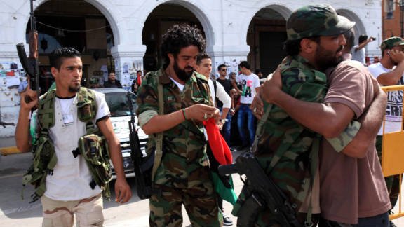 Libyan NTC fighters are congratulated Thursday during celebrations in the streets of Tripoli after news of Moammar Gadhafi