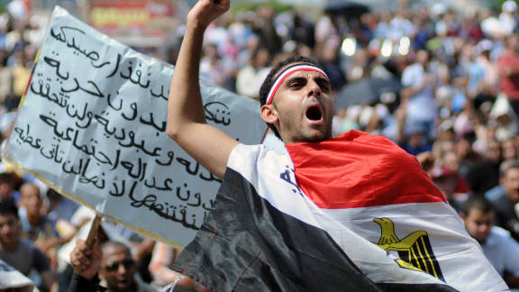 An Egyptian protester shouts slogans in Cairo during a rally amid anger over the military rulers