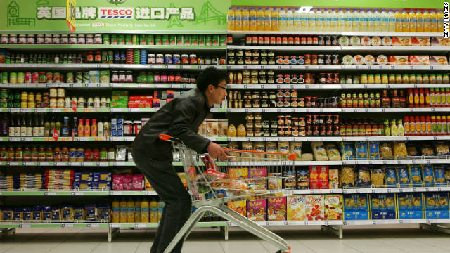 A Beijing resident shops at a Tesco supermarket, a UK-based chain that entered the Chinese market in 2004.