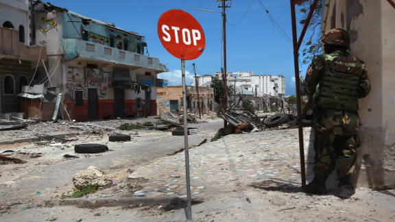 An African Union soldier guards a street corner in Mogadishu, Somalia, in August 2011, after Al-Shabaab militants withdraw.