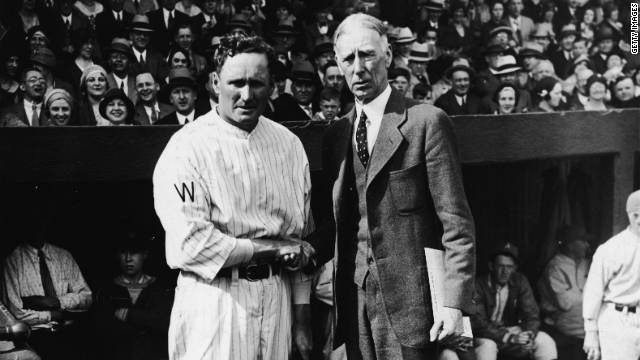 Wearing a suit, Philadelphia Athletics manager Connie Mack greets Walter Johnson, pitcher for the Washington Senators, in 1910.