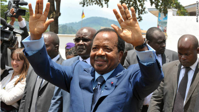Cameroon's President Paul Biya waves to supporters on the campaign trail earlier this month.