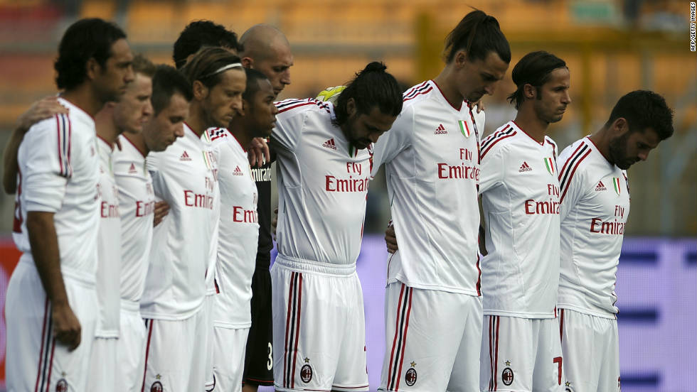 AC Milan players hold a minute's silence for Simoncelli before the start of their Serie A match Sunday.
