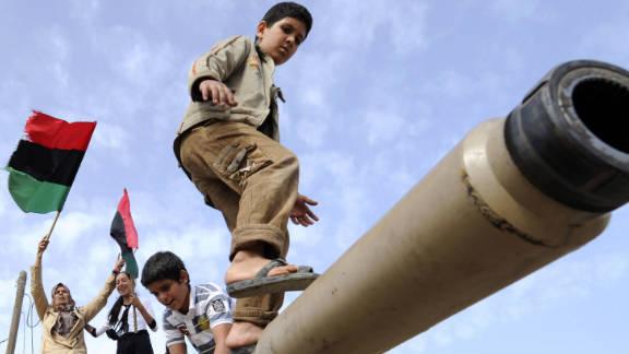 Children play on a tank that belonged to the Gadhafi regime in Misrata, Libya, on Sunday.