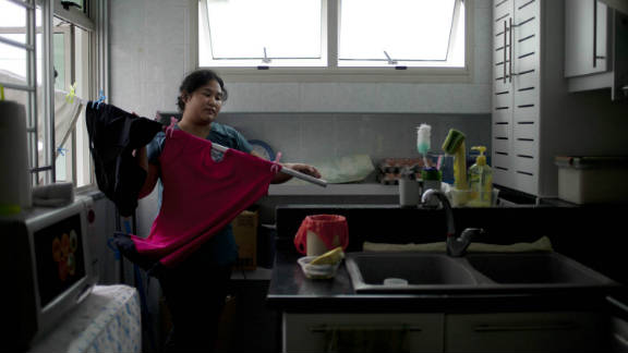 """While working as a journalist in Singapore, Sim Chi Yin was struck by the response of ordinary people to the suggestion that domestic workers should be entitled to a day off. """"I was coming up against editors and readers who were very angry every time that sort of story appeared because they probably didn"""