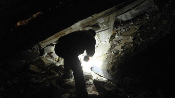 A Turkish man searches for survivors in the rubble on Sunday.