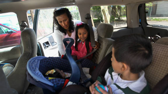 Mexican immigrant Jeanette Vizguerra loads her children into her car after a meeting at the Mexican consulate in her fight against deportation hearings on May 23, 2011, in Denver.