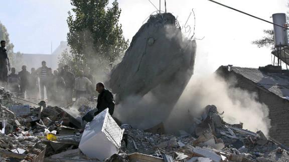 A man walks through the rubble in Van on Monday.