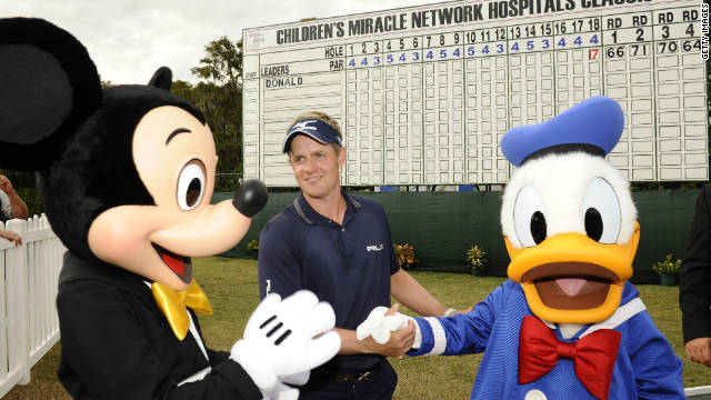 Luke Donald is congratulated by Mickey Mouse and Donald Duck after his decisive victory at the Walt Disney World Resort tournament on Sunday.