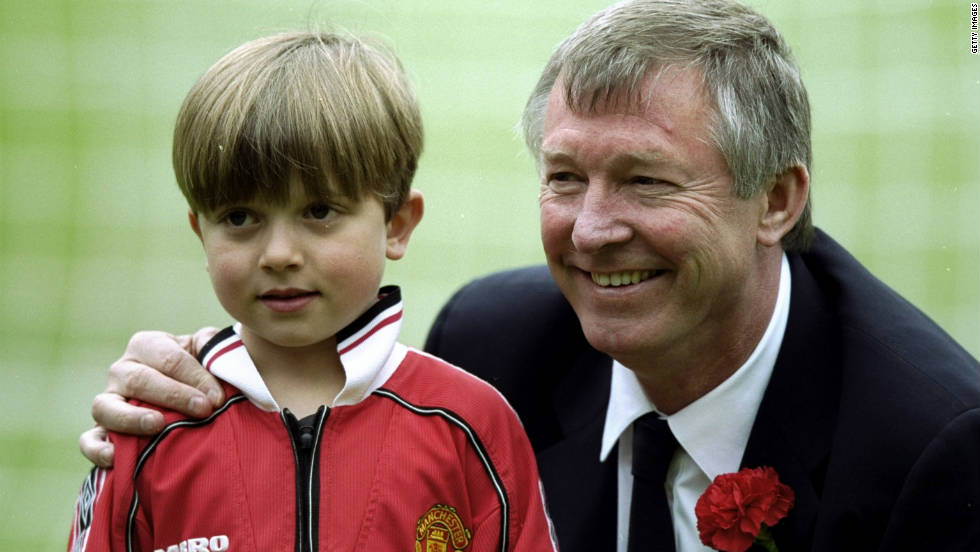 Ferguson with his grandson Jake before the 1999 FA Cup final victory against Newcastle that sealed United's third double in six years.