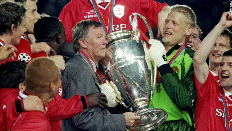 Just four days later, United completed a treble with an incredible last-gasp win over Bayern Munich in the Champions League final. Ferguson and keeper Peter Schmeichel hold the trophy in Barcelona.