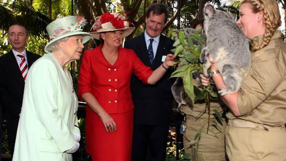 Queensland Premier Anna Bligh shows Queen Elizabeth II a koala during a visit to Rainforest Walk, Southbank, in October  2011, in Brisbane, Australia.