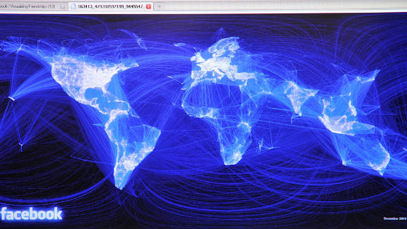 This map shows the global community of Facebook friendships, displayed as lights on a deep  blue background.