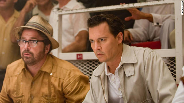 "Paul Kemp (Johnny Depp, right) tries to figure out his place in paradise in ""The Rum Diary."""