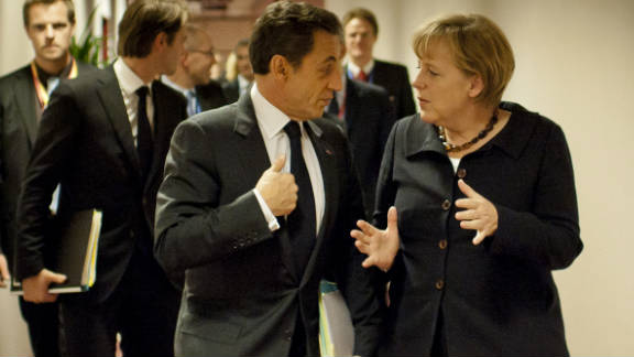 German Chancellor Angela Merkel and French President Nicolas Sarkozy attend an emergency meeting of EU leaders in Brussels.