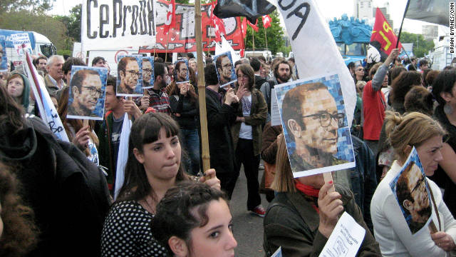 Demonstrators gather outside the Argentina courthouse where 16 former military officers were found guilty.