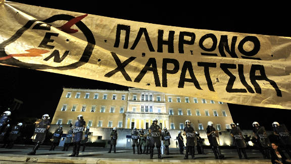 Demonstrators hold a huge banner that reads 'I wont pay the head-tax' in front of the Greek parliament on September 25.