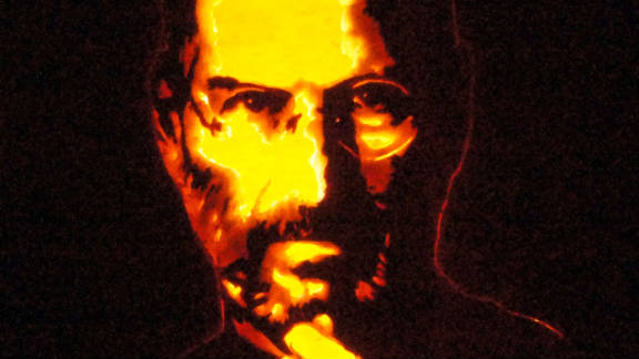 """Keyvin Pollington of Sandy, Utah, """"painted"""" a portrait of Apple founder Steve Jobs by copying an iconic photograph. He created subtle changes in shading by carving away different thicknesses of the pumpkin wall without cutting all the way through."""