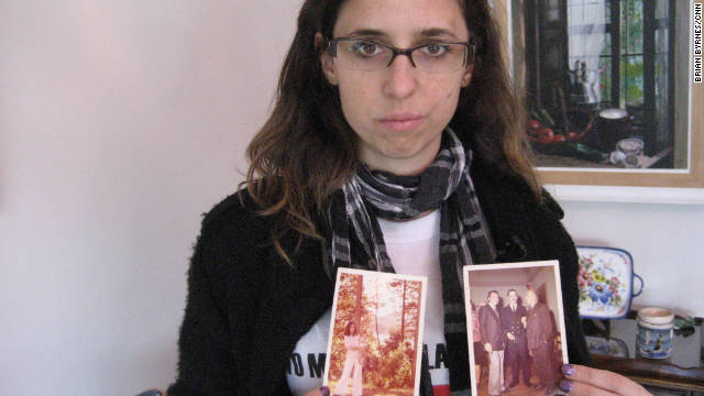 "Marianela Galli, 35, holds photographs of family members who were tortured and killed during Argentina's ""Dirty War."""