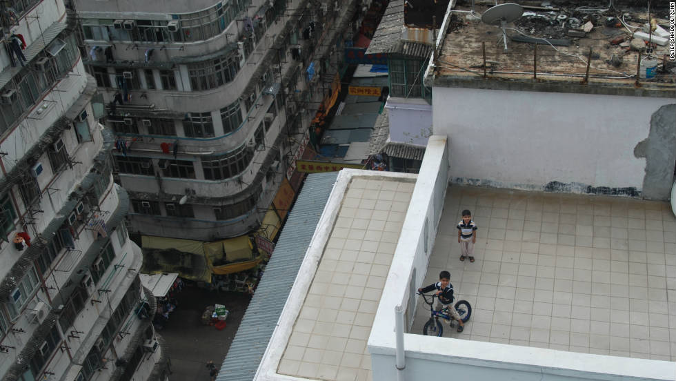 Children on a rooftop playground in Sham Shui Po.