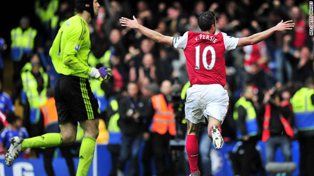 Robin van Persie celebrates scoring his second, and Arsenal's fourth goal against Chelsea at Stamford Bridge.