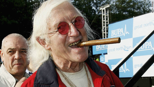 Veteran British radio DJ and TV presenter Jimmy Savile cut a distinctive figure, with cigar, tracksuit and chunky jewelry.