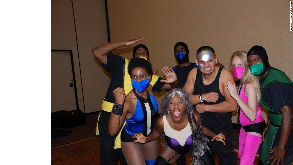 "Kendra Murray of Huntsville, Alabama, and her salsa dance team spiced up a Halloween party with these ""Mortal Kombat"" costumes she made. The team ended up winning best group costume at a Halloween salsa party."