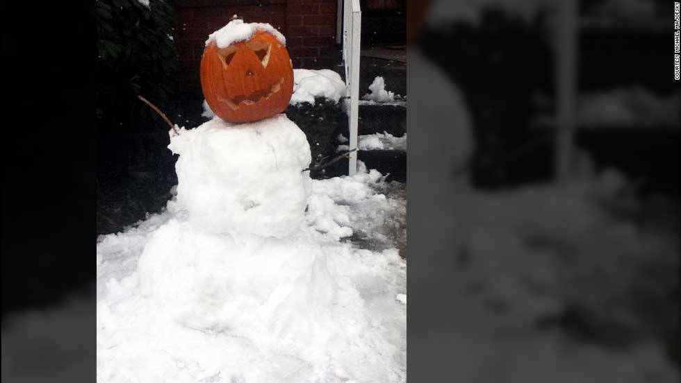 "iReporter Michael Majofsky and his daughter made a snowman with a pumpkin as its head in Pennsylvania. ""We're used to early snow fall,"" he said, ""but this is a little earlier then usual."""