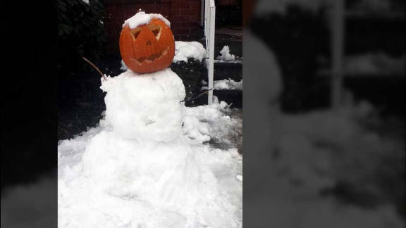 "iReporter Michael Majofsky and his daughter made a snowman with a pumpkin as its head in Pennsylvania. ""We"