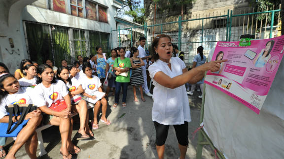 A Philippine health worker discusses family planning  with a class of pregnant women in suburban Manila this year.