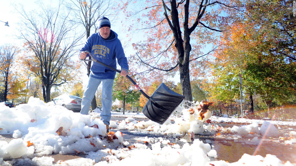Jim Nisula of Doylestown, Pennsylvania, shovels snow outside his home on Sunday, October 30. More than 4 million people lost power in their homes due to the storm.