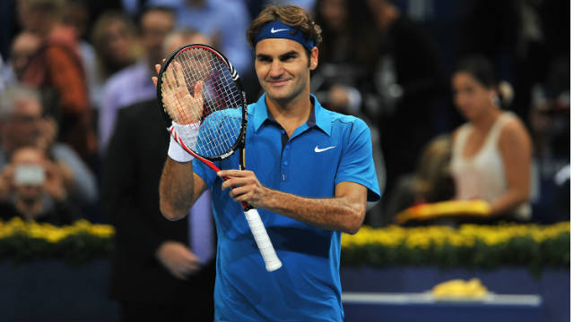 Roger Federer applauds his home crowd after winning his opening match in Basel.